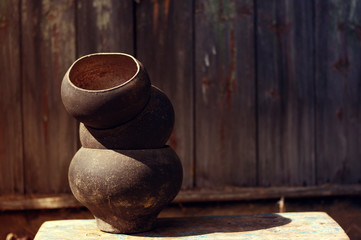 Old cast iron pot on a textural wooden surface. Old ware for the furnace