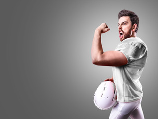 Football Player on white uniform on gray background