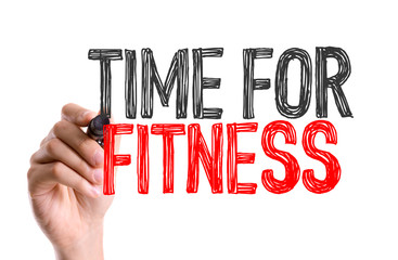 Hand with marker writing the word Time for Fitness
