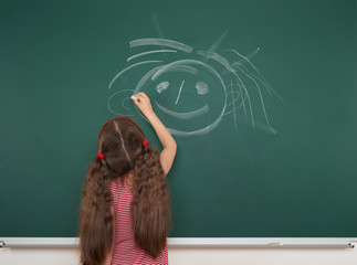 girl drawing on school board