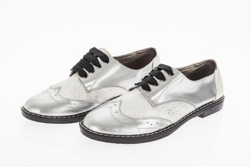 shoe made of grey leather with laces for women on white background