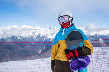 Snowboarder woman in mountains