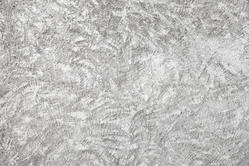 Closeup white concrete wall texture with relief plaster