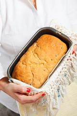 Female hands holding handmade bread