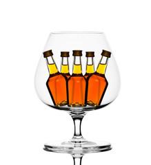 Cognac glass with little bottles inside