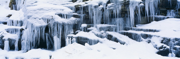 Icicles and snowy rocks in Sierra Nevada Mountains, California
