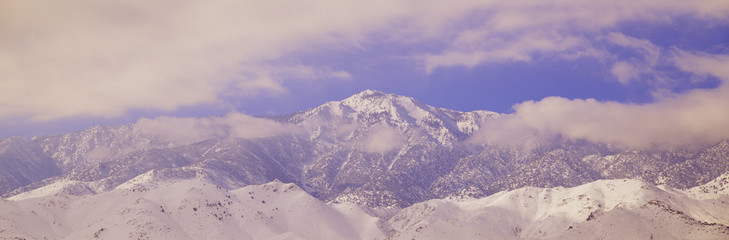 Snowy mountains and clouds in Sierra Nevada Mountains, California