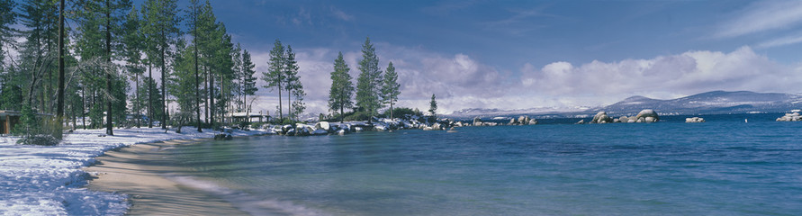 Wall Mural - This is the sandy beach at Lake Tahoe. It shows the turquoise water in the winter after a snow storm.