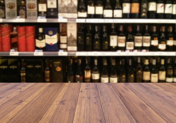 wood plank and wine Liquor bottle on shelf - Blurred background