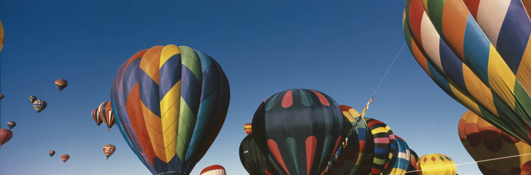 This is the 25th Annual Albuquerque International Balloon Fiesta. It shows the mass ascension of colorful balloons.