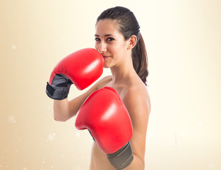 Sport woman with boxing gloves