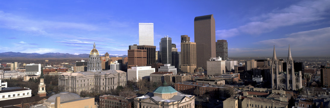 This is the skyline, State Capitol and Rocky Mountains. It shows morning light on what is known as the Mile High City.