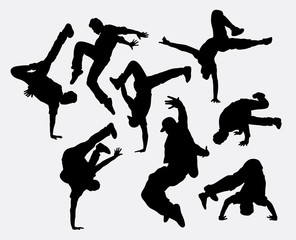 People breakdance silhouettes