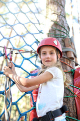 Agile girl travels the trail rope park