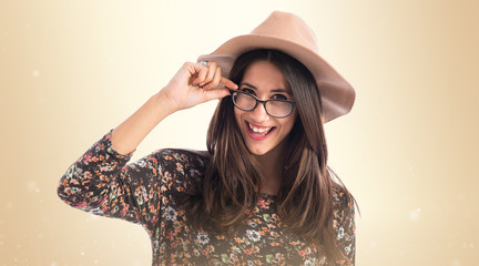 Pretty woman with glasses over white background