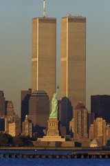 These are the World Trade Towers and Statue of Liberty at sunset. It is the view from New Jersey.