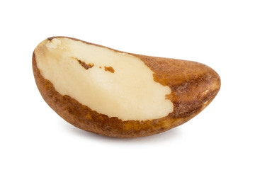 Close-up of a single brazil nut with a shadow, isolated on white background.