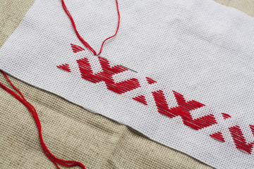 Ukrainian national red embroidery thread, selective focus
