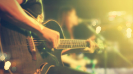 Guitarist on stage for background, soft and blur concept, Vintage  tone