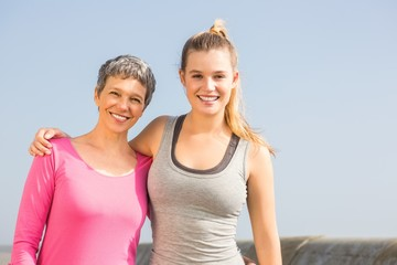 Sporty mother and daughter smiling