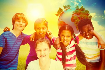 Composite image of happy children forming huddle at park