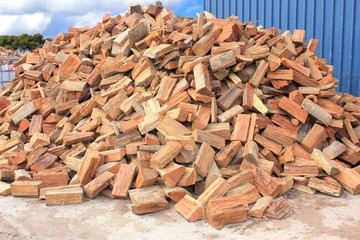 Split and chopped fire wood pile