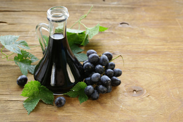 balsamic vinegar in a glass jug with fresh grapes