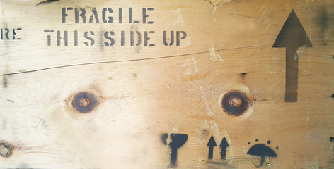 Fragile with Handle with care message type printed on wooden box