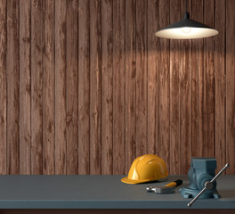 work table of a carpenter, helmet and hammer on wooden wall back