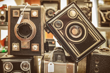 Sepia toned image of old box cameras