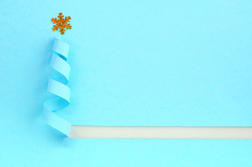 Handmade Christmas tree cut out from blue paper.