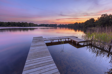 Wall Mural - Sunset over Serene Water of a Lake