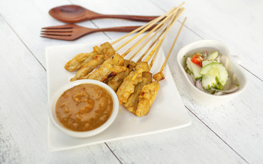 Pork Satay with peanut sauce and cucumber sauce