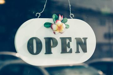 open sign on glass door