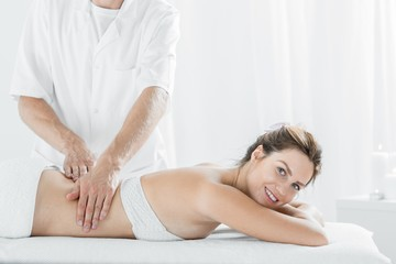 Beautiful woman during relaxing massage