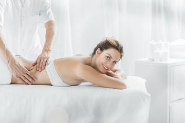 Modern female in massage salon
