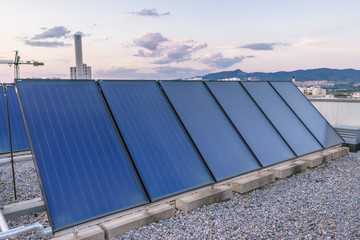 Solar panels / In the picture we can see a solar panels located on the roof of a building