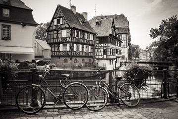Bicycles in front of the River and Houses in Strasbourg, sepia edit