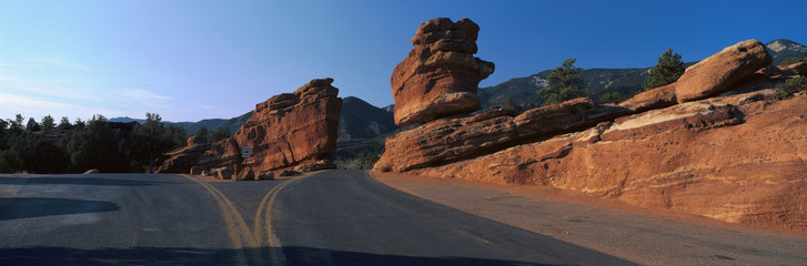 Balanced rock and road in desert