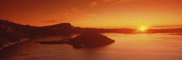 Sun rising over Crater Lake National Park, Oregon