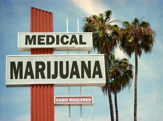 aged and worn vintage photo of medical marijuana clinic with palm trees