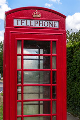 Red Telephone Box with Blue Sky