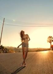 woman in bikini on the street
