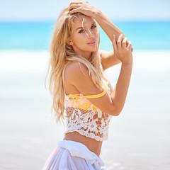 Adorable girl posing on the beach