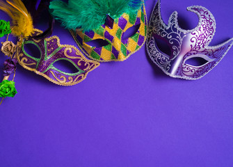 Wall Mural - Mardi Gras or carnival mask on purple background