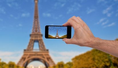 Person taking a photo in Paris