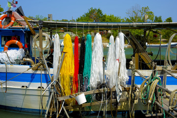 colorful, floating nets of a fishing boat of Lake Varano, Puglia. Italy