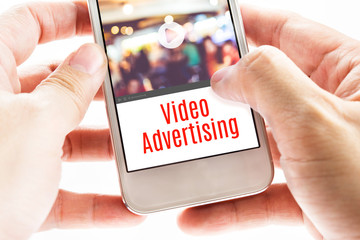Close up Two hand holding mobile with Video Advertising word, Di