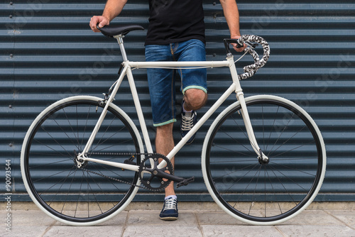 Hipster Man With A Fixie Bike In Metallic Wall Stock Photo And