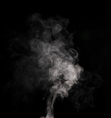 White smoke on black background